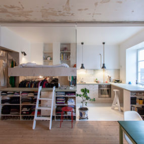 Cleverly Renovated Tiny Apartment Keeps Unfinished Plaster Walls