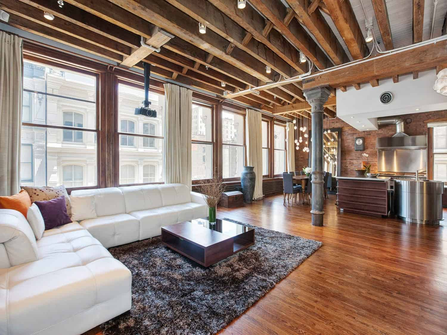 Uncategorized Exposed Wooden Beams open plan apartment with exposed wood beams and iron columns