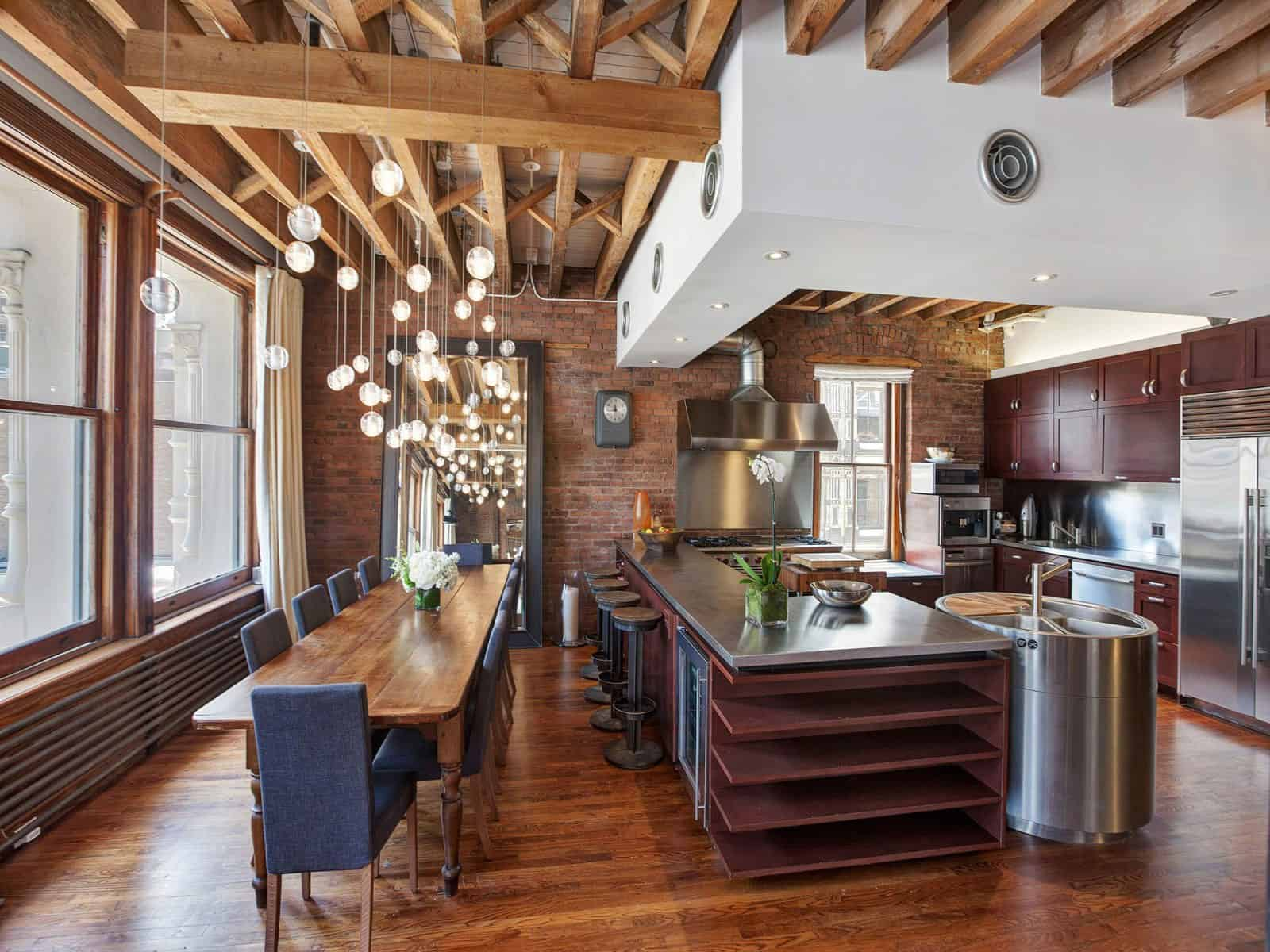 Open Plan Apartment With Exposed Wood Beams And Iron Columns