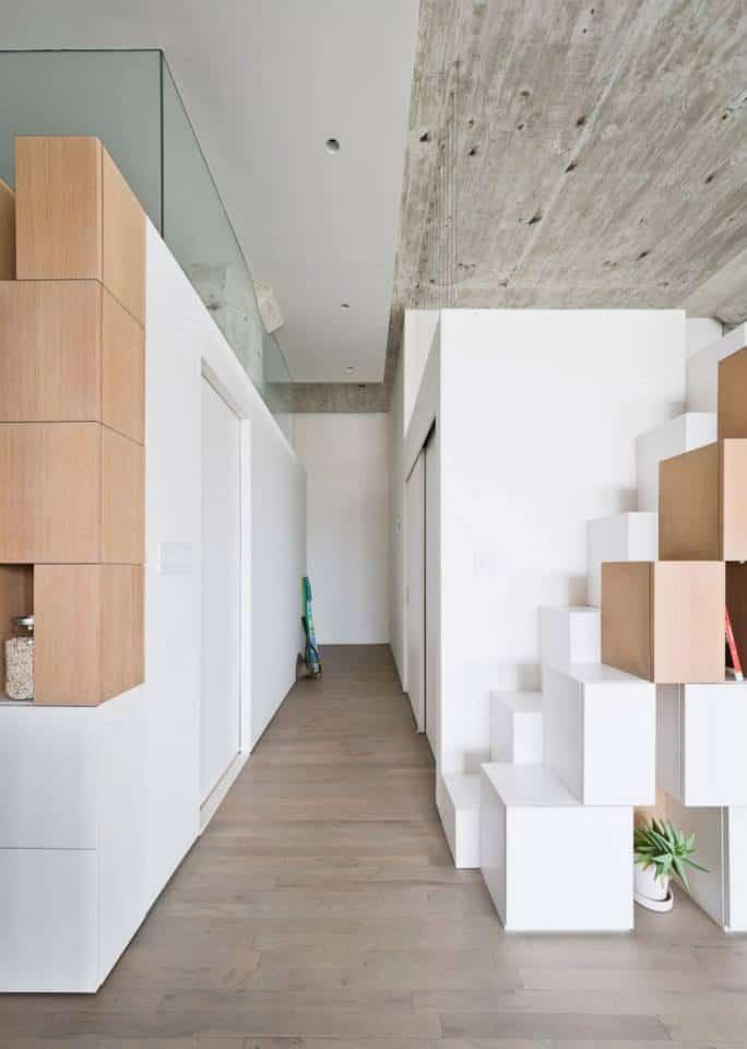 Stairwell Storage creative storage wall incorporates stairwell to new mezzanine