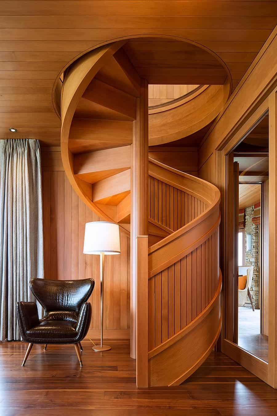 flowing spiral wood staircase is a work of art. Black Bedroom Furniture Sets. Home Design Ideas