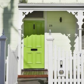 Green Entry Door Sets the Green Motif for the Entire House