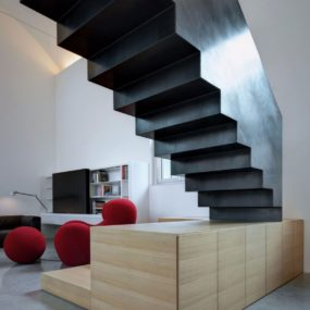 Buratti Architetti Makes Massive Black Metal Staircase Fit Seamlessly into Modern Space