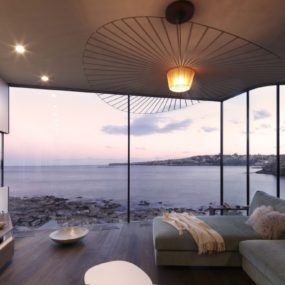 Views Of The Ocean living room with a view of the ocean and of the fire
