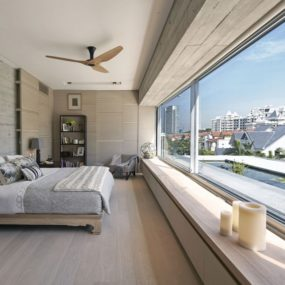 Modern Bedroom Maximizes Urban Skyline View