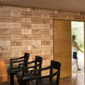 Bar Walls Decorated in Wine Crate Panels – this begs for a DIY project