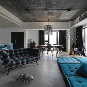 Black, Grey and Blue Living Room Filled with Roche Bobois and Vitra furniture