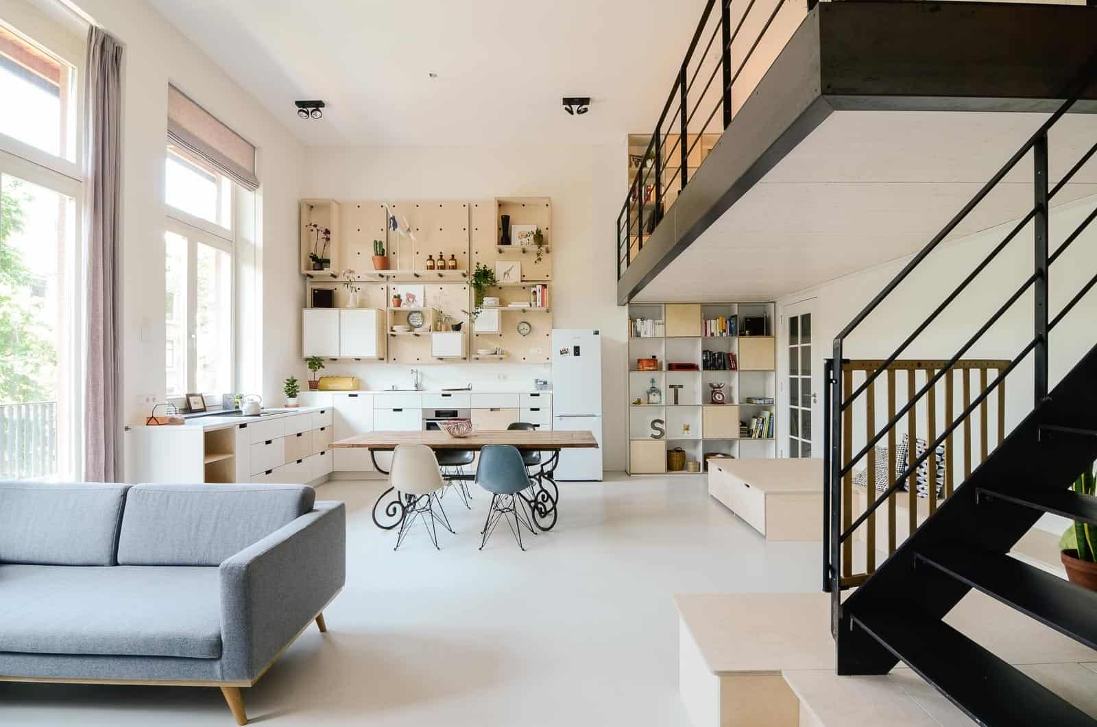 Old schoolhouse converted into 10 loft apartments for 45m2 apartment design