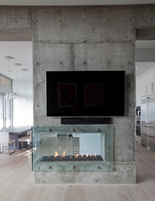 double-sided-modern-fireplace-room-divider-concrete-and-glass.jpg