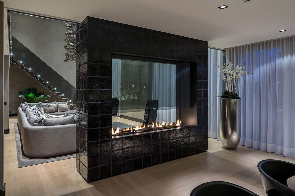 Fireplaces as Room Dividers: 15 Double Sided Design Ideas