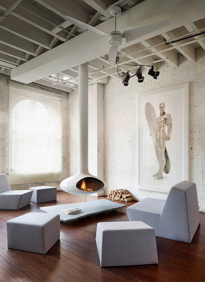 When going for a white aesthetic you have the opportunity to feature a white fireplace and thats exactly what the designer did in this super cool loft