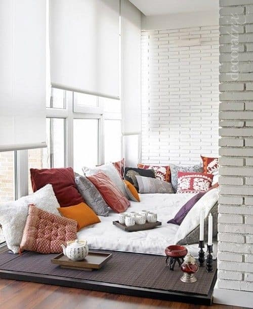 This All White Room Has Been Given A Bohemian Vibe With Its Cushy Rug And Eclectic Assortment Of Colorful Pillows