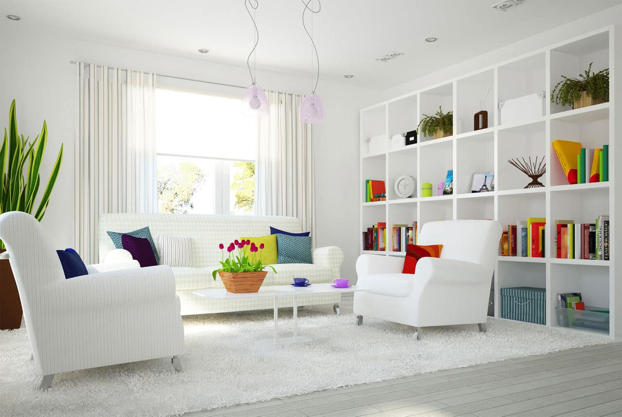 The Bright Pops Of Color In This All White Room Creates A Balanced And Rhythmic Connection Between Bookshelf Sitting Area