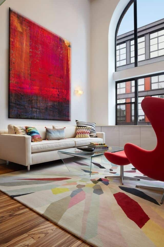 This Living Room Above Has Red Accents Everywhere But Especially In The Feature Painting Sofa There S Nothing Like Right Piece Of Artwork