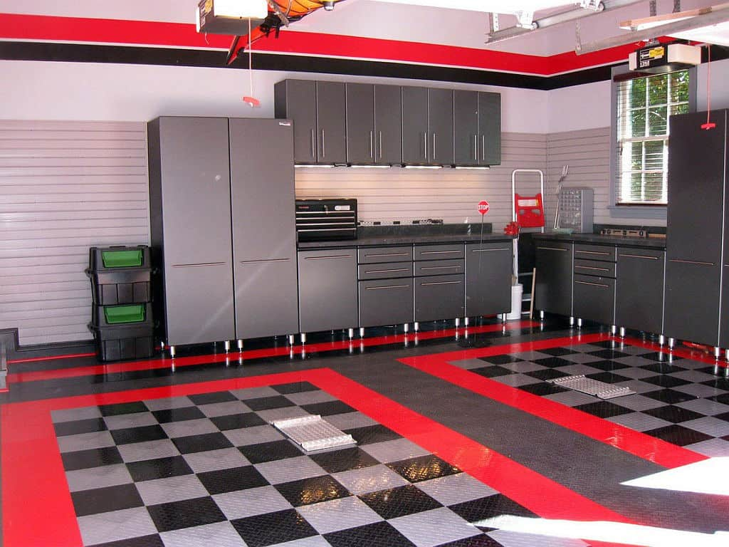 Decorating with red accents 35 ways to rock the look a good red floor design transitions into the realm of garages seamlessly a few wide bands surrounding each checkerboard car bay takes what is normally a dailygadgetfo Image collections