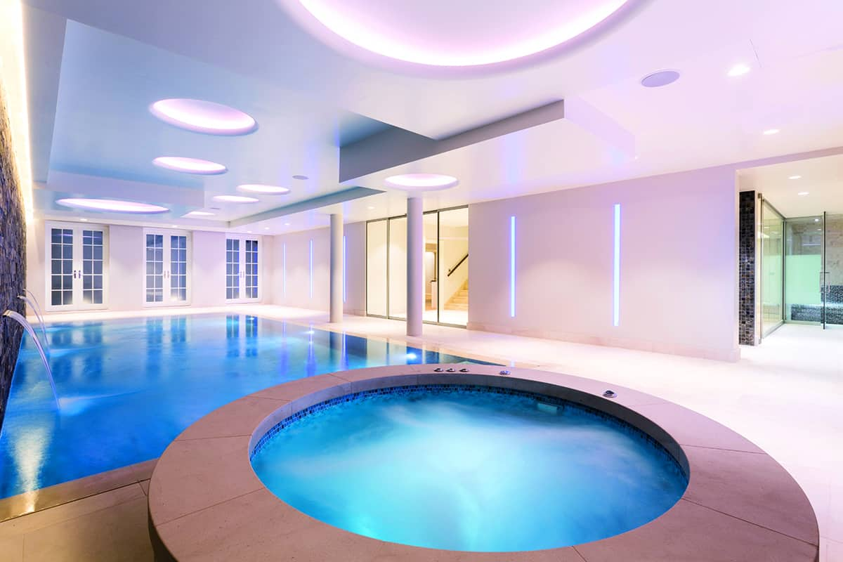 Indoor pool and hot tub with a slide  55 Most Awesome Swimming Pool Designs on the Planet