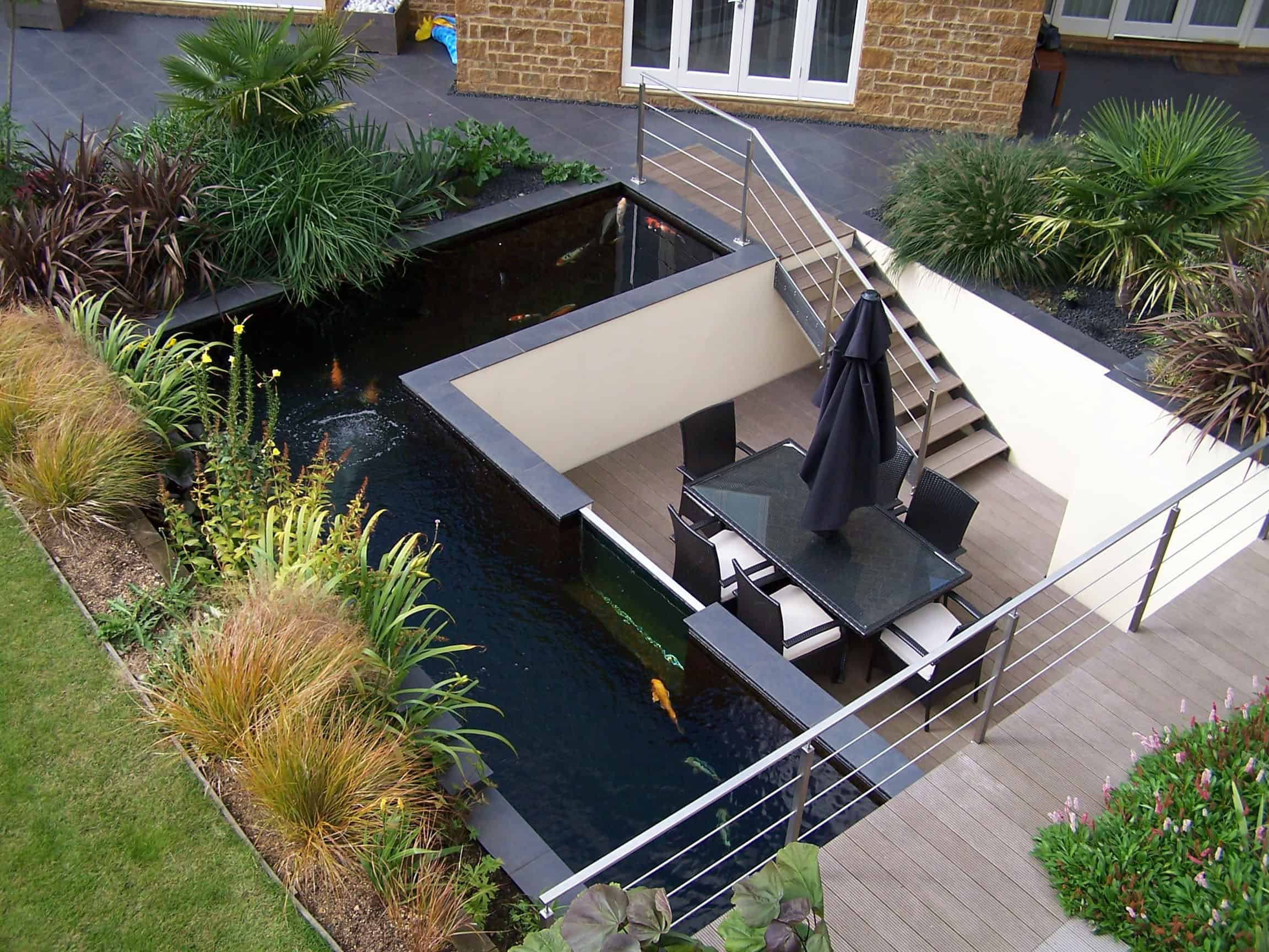 35 Sublime Koi Pond Designs and Water Garden Ideas for ... on Koi Ponds Ideas id=47916