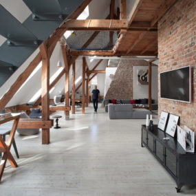 Office Attic Converted Into Loft Apartment Keeping Original Wood and Brick