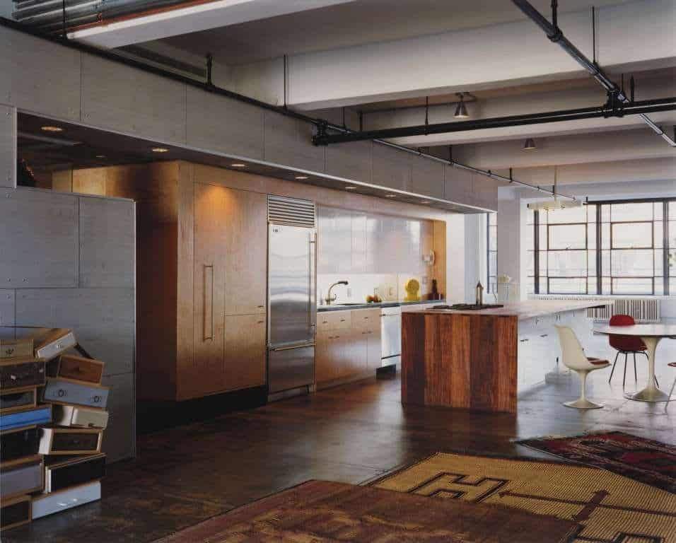 Eclectic loft with acid etched concrete floors for New york style kitchen design