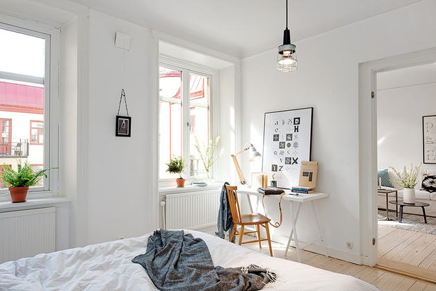 casually-comfortable-decor-driven-apartment-sweden-bedroom-ceiling-light.jpg