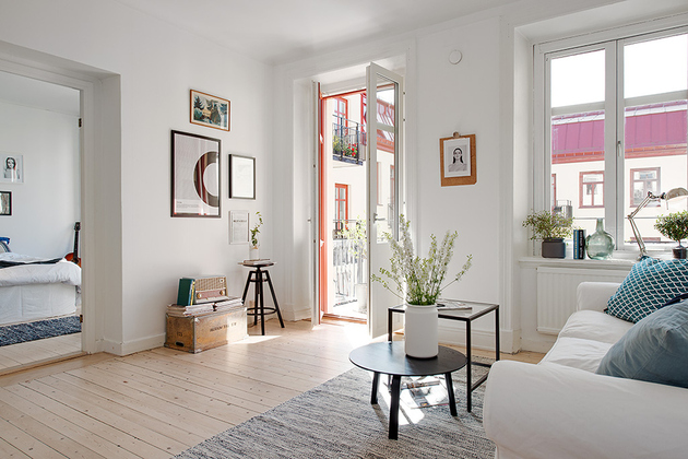casually-comfortable-decor-driven-apartment-sweden-deck-door.jpg