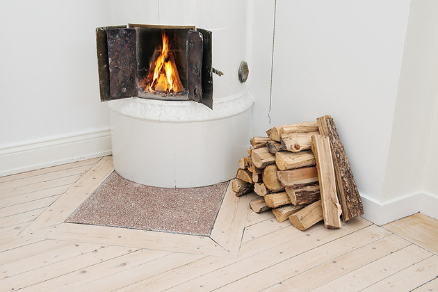 casually-comfortable-decor-driven-apartment-sweden-fire-close-up.jpg