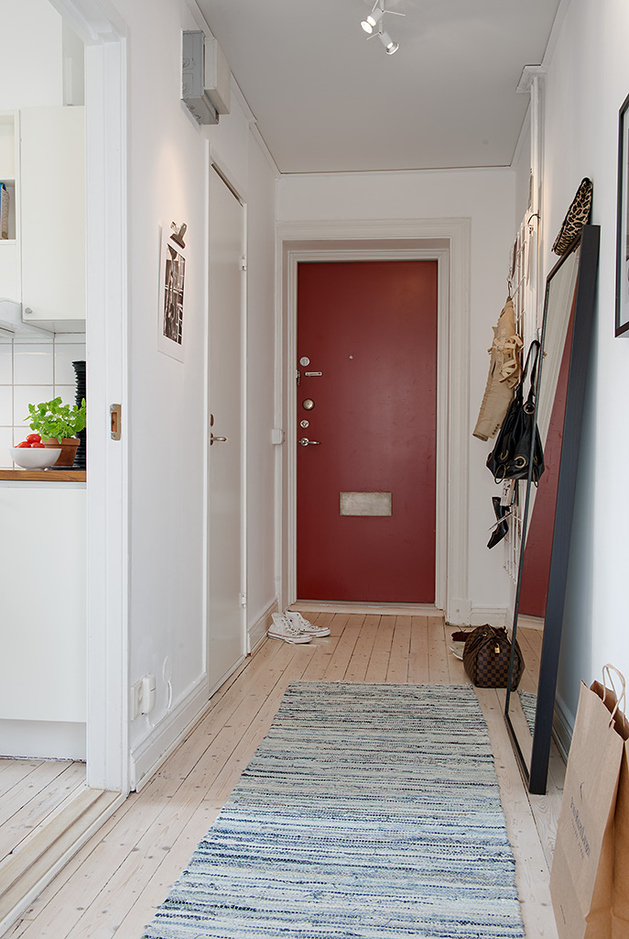 casually-comfortable-decor-driven-apartment-sweden-red-door.jpg