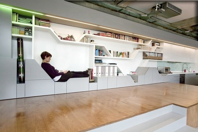 industrial loft with seating integrated into shelves 1 lounge seat thumb 630xauto 37190 Industrial Loft With Seating Integrated Into Shelves