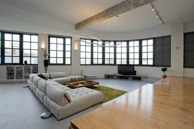 industrial-loft-with-seating-integrated-into-shelves-5-living-area.jpg