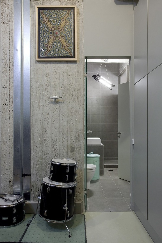 industrial-loft-with-seating-integrated-into-shelves-8-public-bathroom.jpg