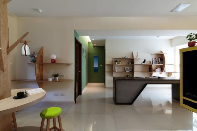 pivoting-tv-turns-playful-apartment-into-entertainment-area-10.jpg