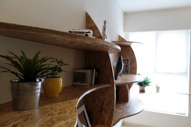 pivoting-tv-turns-playful-apartment-into-entertainment-area-12.jpg