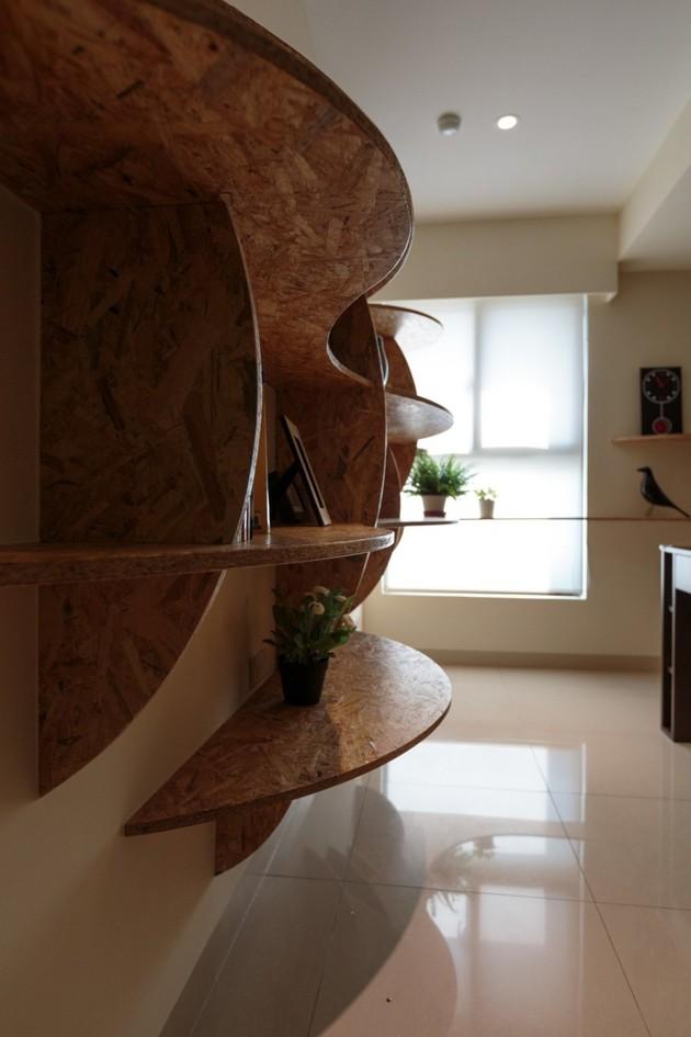 pivoting-tv-turns-playful-apartment-into-entertainment-area-13.jpg