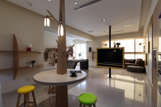 pivoting-tv-turns-playful-apartment-into-entertainment-area-14.jpg