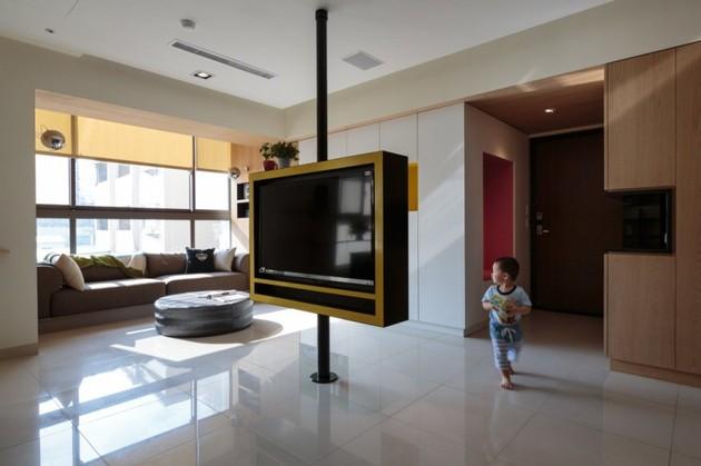 pivoting-tv-turns-playful-apartment-into-entertainment-area-3.jpg