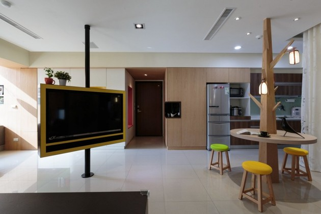 pivoting-tv-turns-playful-apartment-into-entertainment-area-4.jpg