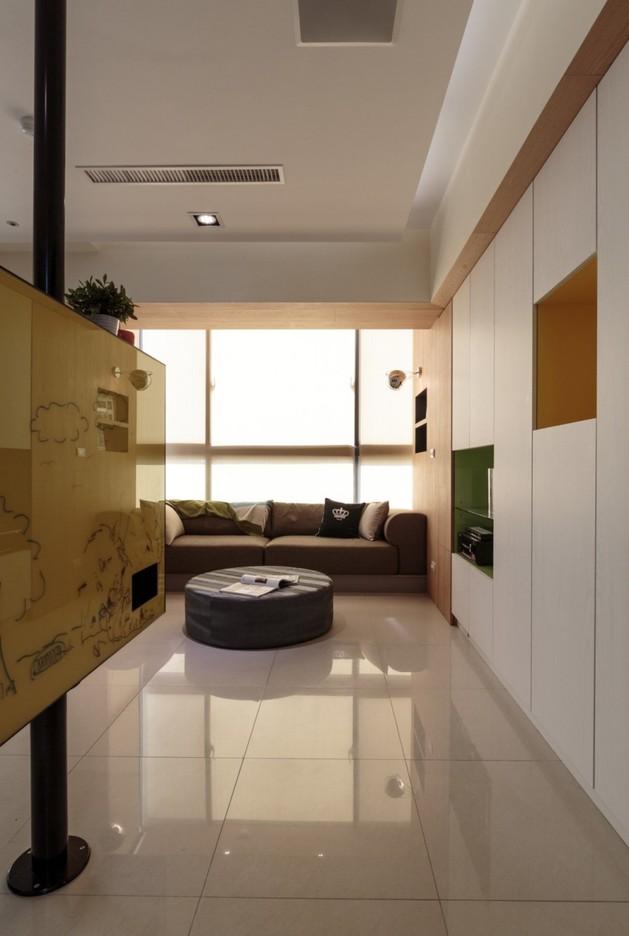 pivoting-tv-turns-playful-apartment-into-entertainment-area-7.jpg