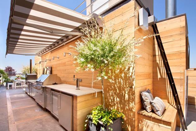 rooftop oasis hot tub fireplace novogratz thumb 630xauto 43279 Urban Rooftop Oasis: Hot Tub, Fireplace and Theater