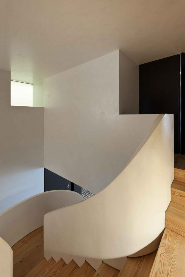 minimalist-home-with-bold-flooring-and-staircase-sculpture-11.jpg