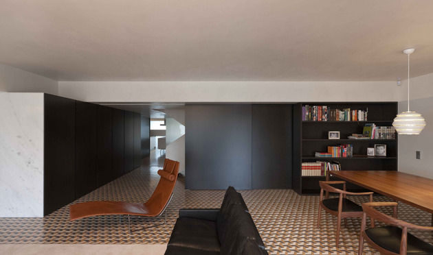 minimalist-home-with-bold-flooring-and-staircase-sculpture-6.jpg