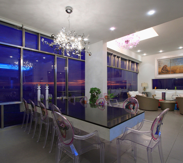 30-louis-ghost-lucite-dining-chairs-at-night.jpg