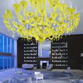 Bold Decor Idea: yellow chandelier against black walls and white floors