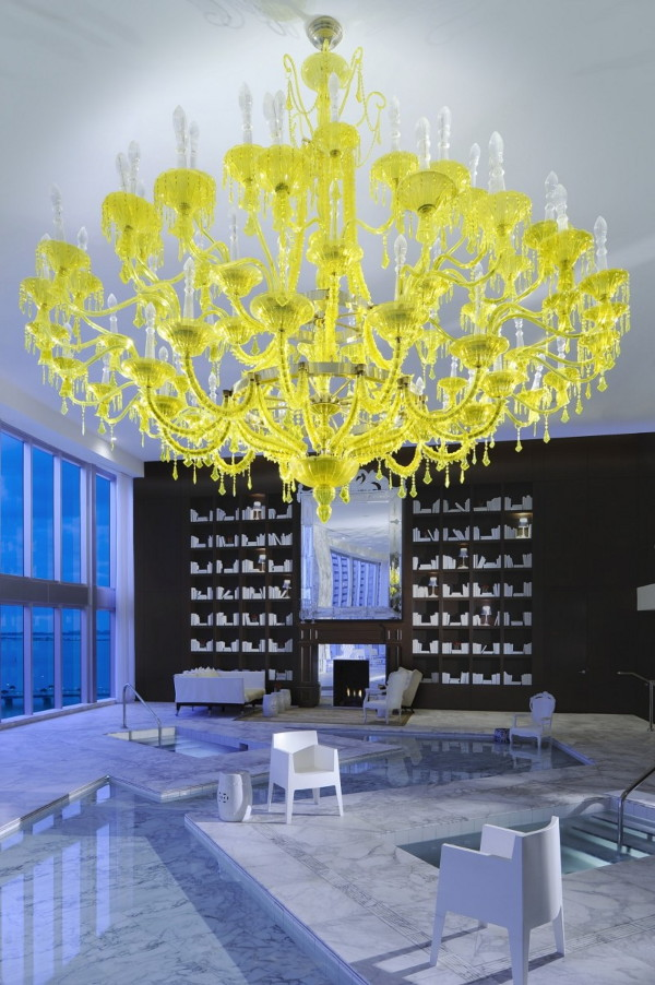 Bold decor idea yellow chandelier against black walls and white floors aloadofball Gallery