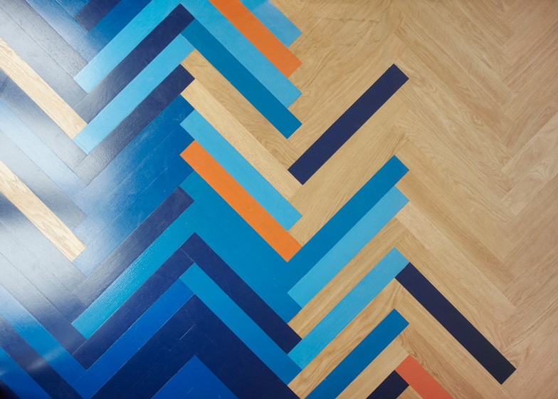 Bright Herringbone Floors Create Colorful Graphic Interiors