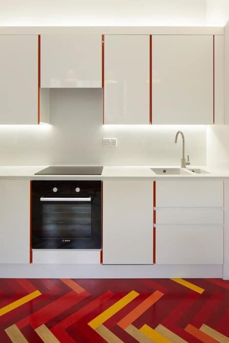 colorful graphic interiors featuring bright herringbone floors 11