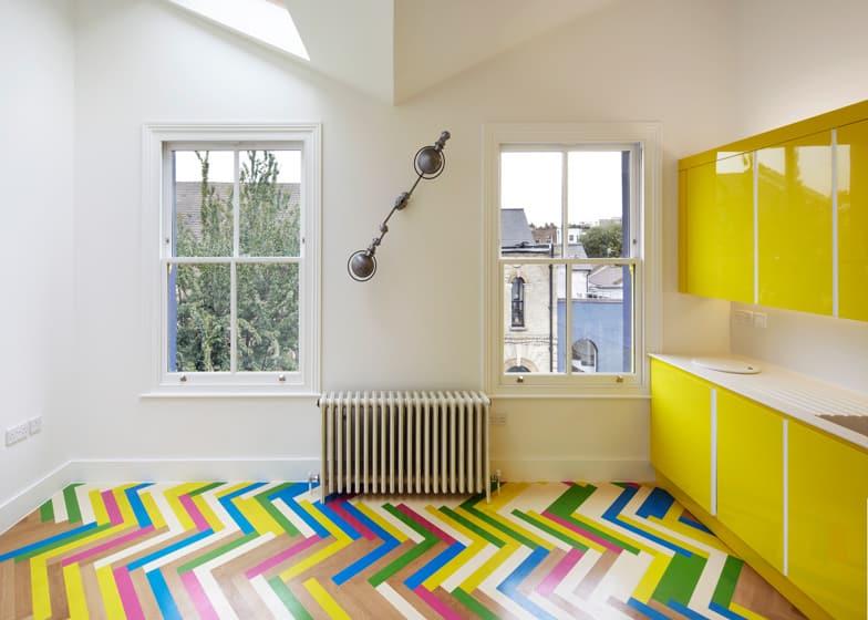Bright Herringbone Floors Create Colorful Graphic Interiors