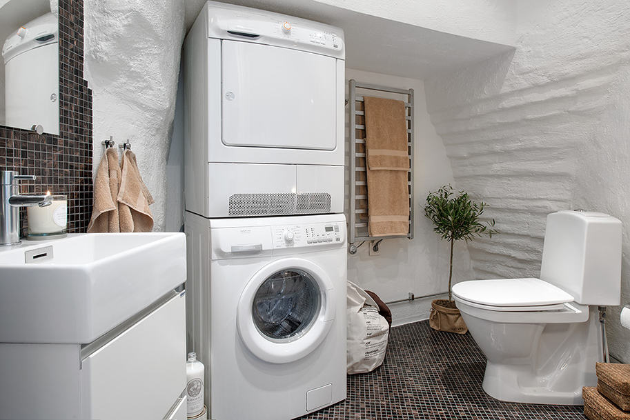 Cozy apartment decorated in pure modern scandinavian style Adding bathroom to laundry room
