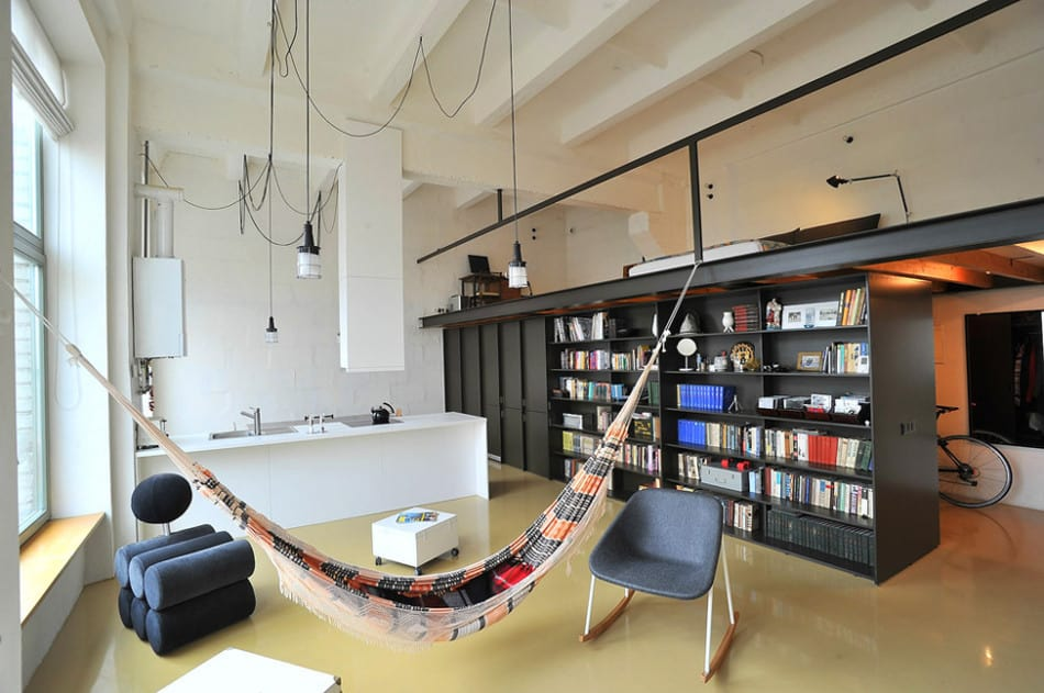 Factory loft with an integrated hammock and a mezzanine - Loft apartment definition ...