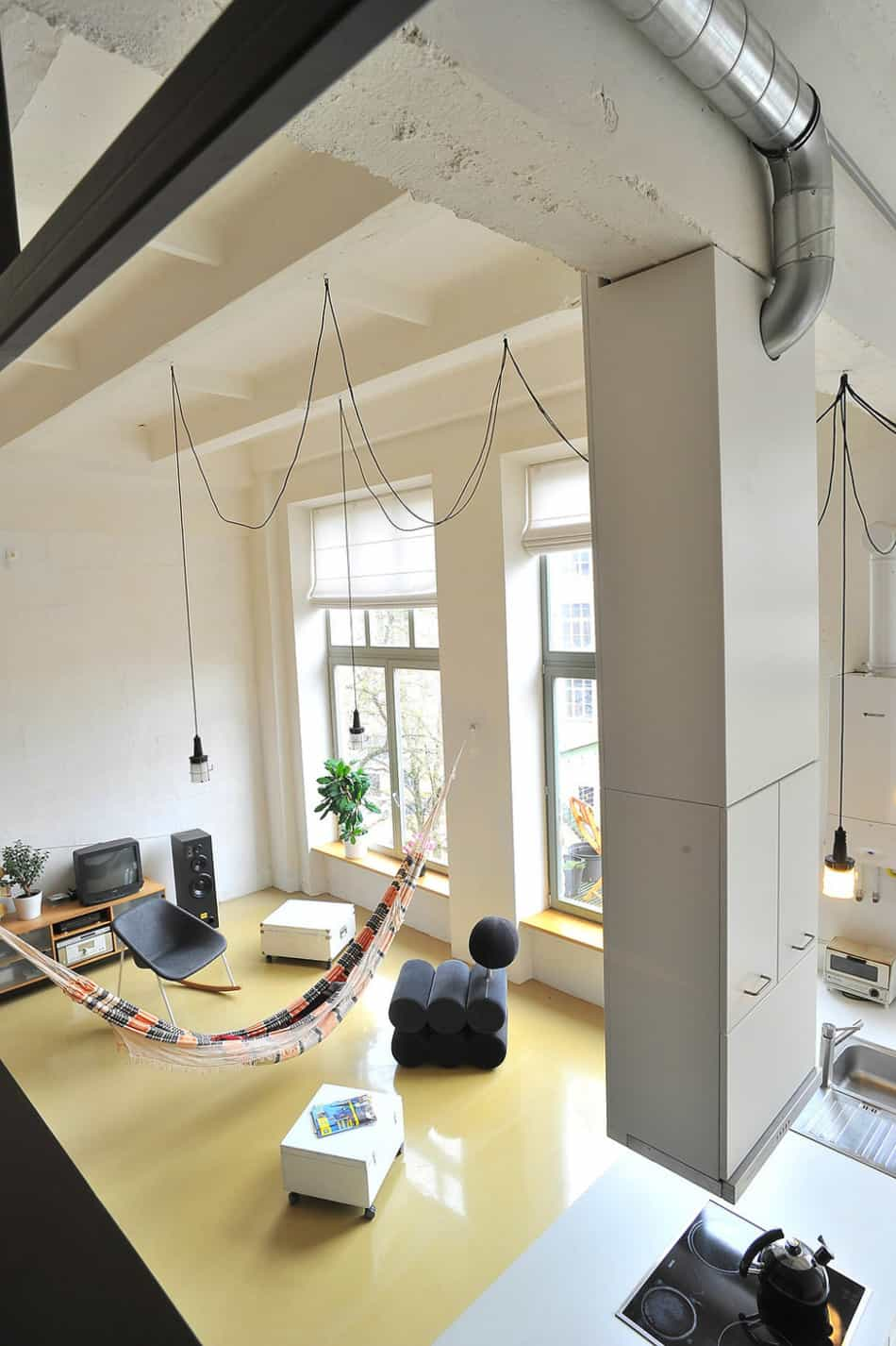 View In Gallery Factory Loft With Integrated Hammock Mezzanine 5 Living