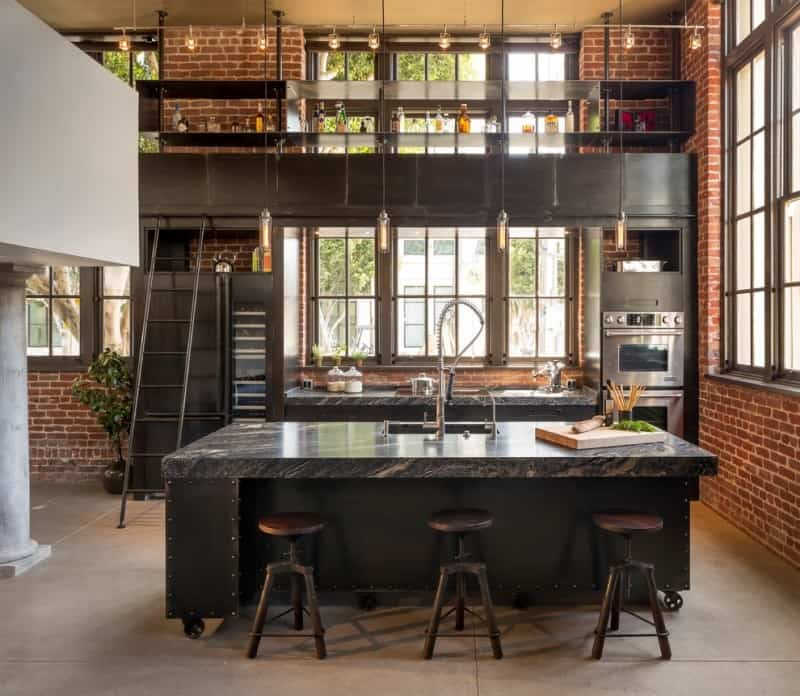 The Entire Kitchen Island Is On Wheels U2013 Lending To The Industrial Motif.  The Distressed Stools Are A Perfect Touch.